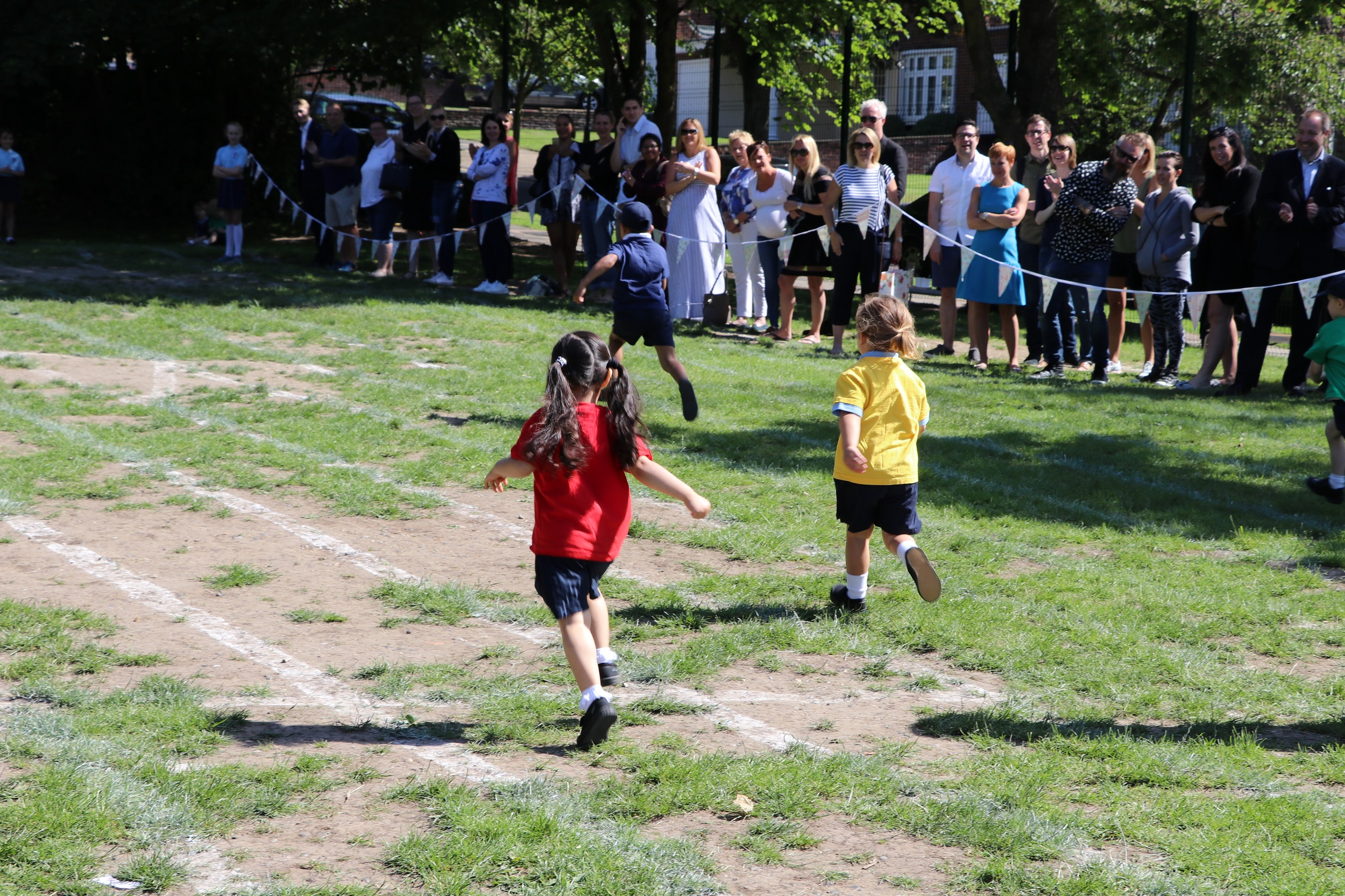 Nursery children race to the finish line