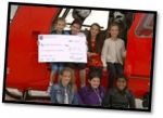 Presenting the cheque to London Air Ambulance